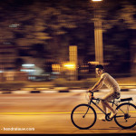 Panning Shot - A biker on Victoria Street in Singapore