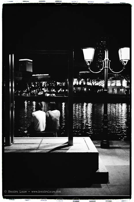 A Couple by the Singapore River at Night